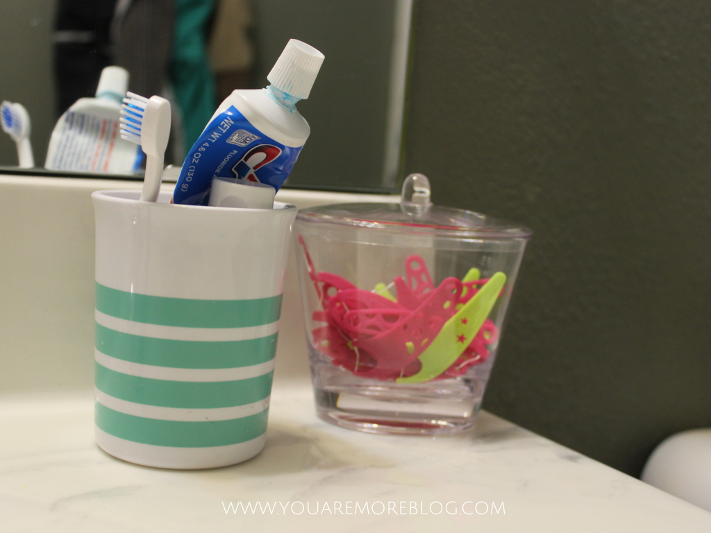Utilize Plastic Storage Containers For Visible Bathroom